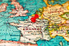 Paris, France pinned on vintage map of Europe.  Stock Image
