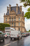 Paris, France. Rainy day, facade of Louvre museum Royalty Free Stock Photo