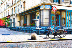 Paris, France, Restaurant Chez Julien, 12 06 2012 - empty tables. And chairs on the street in the center of the city royalty free stock photos