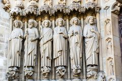 Sculptures on the Portal of the Last Judgment on the main western facade of the Cathedral of Notre Dame de Paris royalty free stock photography