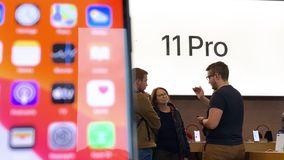 Apple Computers iPhone 11 Pro and Pro Max goes on sale. Paris, France - Sep 20, 2019: Customers buying Apple Watch and iPhone Pro 11 Pro Max in Apple Store as stock video footage