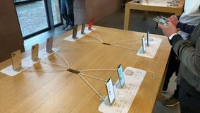 Apple Computers iPhone 11 Pro and Pro Max goes on sale. Paris, France - Sep 20, 2019: Friends looking at the new iPhone 11 Pro Max are displayed in Apple Store stock video