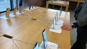 Apple Computers iPhone 11 Pro and Pro Max goes on sale. Paris, France - Sep 20, 2019: Man looking at the new iPhone 11 Pro Max are displayed in Apple Store as stock footage