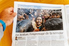 Man reading newspaper about rohingya refugees Royalty Free Stock Photography