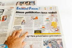 Man reading newspaper Sabah turkey newspaper about politics in E. PARIS, FRANCE - SEP 25, 2017: Man reading Turkish Sabah newspaper about politics in Poland Royalty Free Stock Photos