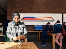 Middle-east ethnicity New iPhone 8 and iPhone 8 Plus in Apple St. PARIS, FRANCE - SEP 22, 2017: New iPhone 8 and iPhone 8 Plus, as well the updated Apple Watch Royalty Free Stock Photo