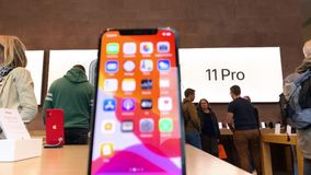 Apple Computers iPhone 11 Pro and Pro Max goes on sale. Paris, France - Sep 20, 2019: Pan over iPhone 11 Pro Max displayed in Apple Store as the smartphone by stock footage
