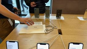 Apple Computers iPhone 11 Pro and Pro Max goes on sale. Paris, France - Sep 20, Time lapse fast motion of man shopping buying an iPhone 11 Pro Max in Apple Store stock video footage