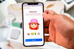 Memoji Animoji characters on iphone Xs New Max with human face royalty free stock photography