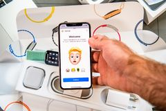 Memoji Animoji characters on iphone Xs New Max with human face stock photography