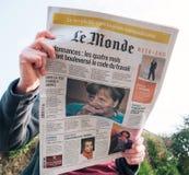 Woman reading le Monde French press Angela Merkel elections Germ