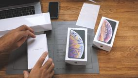 Man unboxing iPhone Xs Max Xr open slowly the box. PARIS, FRANCE - SEPTEMBER 21, 2018: Apple fan boy unboxing latest new Apple iPhone Xs Max and Xs flagship stock video footage
