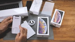 Man unboxing iPhone Xs Max Xr choose region and country. PARIS, FRANCE - SEPTEMBER 21, 2018: Apple fan boy unboxing latest new Apple iPhone Xs Max and Xs stock video
