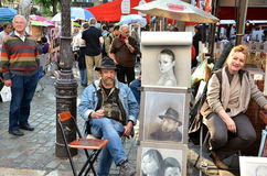 PARIS / FRANCE - September 24, 2011: Artists display their work in Montmartre. Montmartre in Paris is place, where many notable artists lived and worked Stock Image