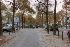 Autumn paris sad Boulevard with falling leaves. Paris, France - September 23, 2017: Autumn sad Boulevard with falling leaves, leaf fall. Paris morning stock image