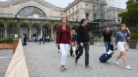 French people and foreigner travelers walking in and out at Gare de Paris-Est. PARIS, FRANCE - SEPTEMBER 5 : French people and foreigner travelers walking in and stock video footage