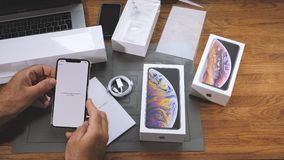 Man unboxing iPhone Xs Max Xr activation of the phone time-lapse. PARIS, FRANCE - SEPTEMBER 21, 2018: new Apple iPhone Xs Max and Xs flagship smartphone mobile stock video footage