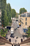Paris, France - September 5, 2014: Overview of a Paris street with cars and people in the autumn Royalty Free Stock Images