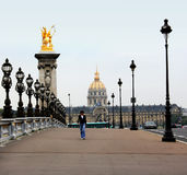 Paris, France - September 17, 2009: Pedestrian walking on the bridge of Alexander III. Stock Image