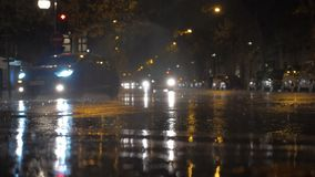 Car traffic on wet road at rainy night, Paris stock footage