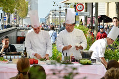 PARIS / FRANCE - September 23, 2011: Street cooking presentation of the FRERES BLANC company in the Avenue des Champs-Elysees Royalty Free Stock Photo