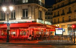 The traditional French cafe brasserie Royal Opera at night., Paris, France. Royalty Free Stock Photos