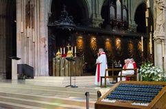 Priests during ceremony at Notre Dame de Paris Cathedral, Paris, France. PARIS, FRANCE - SEPTEMBER 7, 2018: Unidentified priests during ceremony at Notre Dame de royalty free stock images
