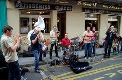 Paris, France: Street Musicians. A group of musicians entertaining on a left bank street during the annual Fête de la Musique festival in Paris, France Royalty Free Stock Images