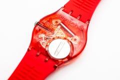 Paris, France 07.10.2020 - Swatch quartz red watch back case battery compartmen