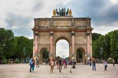 PARIS, FRANCE. Triumphal Arch (Arc de Triomphe d. PARIS, FRANCE - JUNE 24, 2016. People walking near the Triumphal Arch (Arc de Triomphe du Carrousel) at Royalty Free Stock Photography