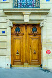 Paris, France - typical old apartment building. Wooden door. Beautiful flowers flowers at a parisian garden during summer time in a flowers store in Paris Stock Photo