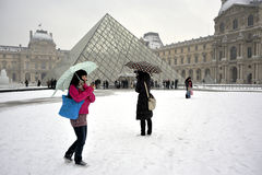 Paris, France, Winter Snow Storm, Pyramid at the L. Ouvre Museum Building.  Credit Architect: I.M. Pei, Japanese TOurists Taking Photos, PS-54247 Stock Images