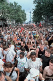 Paris Gay Pride, Crowd Scene. PARIS- Act Up Paris, Organisation Fighting AIDS, Crowd Following Truck at the Gay Pride March, 1999 Royalty Free Stock Photos