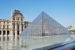 Paris. Glass pyramid in Louvre Stock Images