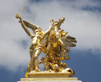 Paris - gold statue from Alexandre III bridge Stock Photography