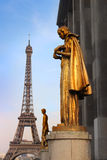Paris golden statue and Eiffel tower stock image