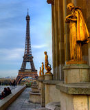 Paris, golden statues on Trocadero. Eiffel Tower as a background of the golden statues on Trocadero Royalty Free Stock Image