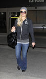 Paris Hilton is seen at LAX airport. LOS ANGELES - FEBRUARY 5: Paris Hilton is seen at LAX . February 5th 2011 in Los Angeles, California Royalty Free Stock Photo