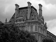 Paris Louvre under cloudy skies royalty free stock photos