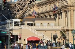 Paris Hotel and Casino, crowd, city, human settlement, plaza. Paris Hotel and Casino is crowd, plaza and palace. That marvel has city, shopping mall and library Stock Photos