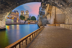 Paris. Image of the Notre-Dame Cathedral and riverside of Seine river in Paris, France Royalty Free Stock Photography