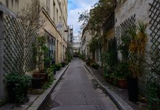 Paris - The industrial city. The XI th district of Paris is full of small secret impasses like this one.Small flower houses, workshops and narrow streets Stock Photography