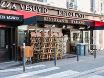 Paris Italian restaurant with stacked chairs Royalty Free Stock Photography
