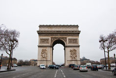 PARIS-JANUARY 10: The Arc de Triomphe in a bad weather on January 10,2013 in Paris. The Arc de Triomphe stands at the western end of the Champs-Élysées in Royalty Free Stock Images
