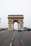 PARIS-JANUARY 10: The Arc de Triomphe on January 10,2013 in Paris. The Arc de Triomphe stands at the western end of the Champs-Élysées in Paris, France Stock Images
