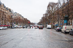 PARIS-JANUARY 10: The Avenue des  Champs-Élysée in a bad weather on January 10,2013 in Paris. Royalty Free Stock Photos