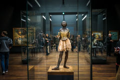 PARIS - January 2, 2016: The sculpture of Little Dancer of Fourteen Years by Edgar Degas in Musée d`Orsay, Paris France. PARIS - January 2, 2016: The stock photos
