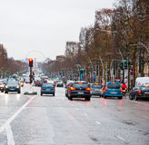 PARIS-JANUARY 10: Traffic on the Avenue des Champs-Élysées in a bad weather on January 10,2013 in Paris. Royalty Free Stock Photography
