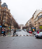 PARIS-JANUARY 10: Typically Parisian street and the Arc de Triomphe in the distance on January 10,2013. Royalty Free Stock Image