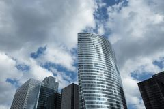PARIS - JULY 2016. EDF office in Paris business district La Defense. Glass facades of modern buildings on a cloudy day Stock Photography